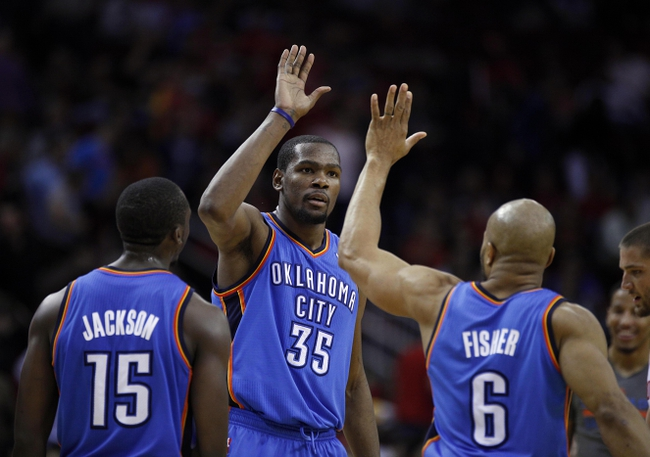 Jan 16, 2014; Houston, TX, USA; Oklahoma City Thunder small forward Kevin Durant (35) high-fives point guard Derek Fisher (6) during the fourth quarter against the Houston Rockets at Toyota Center. Mandatory Credit: Andrew Richardson-USA TODAY Sports