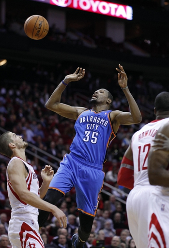 Jan 16, 2014; Houston, TX, USA; Oklahoma City Thunder small forward Kevin Durant (35) is fouled during the fourth quarter against the Houston Rockets at Toyota Center. Mandatory Credit: Andrew Richardson-USA TODAY Sports