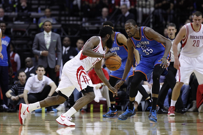 Jan 16, 2014; Houston, TX, USA; Houston Rockets shooting guard James Harden (13) is guarded by Oklahoma City Thunder small forward Kevin Durant (35) during the fourth quarter at Toyota Center. Mandatory Credit: Andrew Richardson-USA TODAY Sports