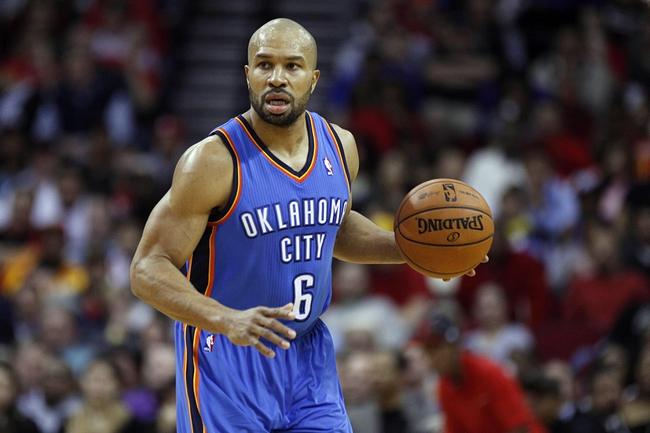 Jan 16, 2014; Houston, TX, USA; Oklahoma City Thunder point guard Derek Fisher (6) with the ball during the fourth quarter against the Houston Rockets at Toyota Center. Mandatory Credit: Andrew Richardson-USA TODAY Sports