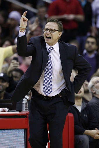 Jan 16, 2014; Houston, TX, USA; Oklahoma City Thunder head coach Scott Brooks reacts to a play during the fourth quarter against the Houston Rockets at Toyota Center. Mandatory Credit: Andrew Richardson-USA TODAY Sports