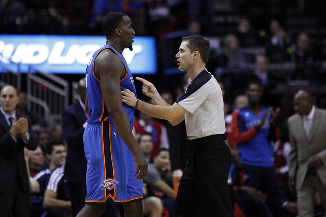 Jan 16, 2014; Houston, TX, USA; NBA referee David Guthrie (16) gives a technical foul to Oklahoma City Thunder center Kendrick Perkins (5) during the fourth quarter against the Houston Rockets at Toyota Center. Mandatory Credit: Andrew Richardson-USA TODAY Sports