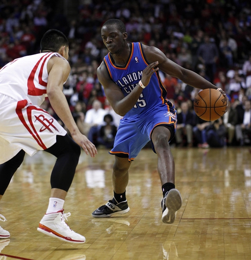 Jan 16, 2014; Houston, TX, USA; Oklahoma City Thunder point guard Reggie Jackson (15) is defended by Houston Rockets point guard Jeremy Lin (7) during the fourth quarter at Toyota Center. Mandatory Credit: Andrew Richardson-USA TODAY Sports