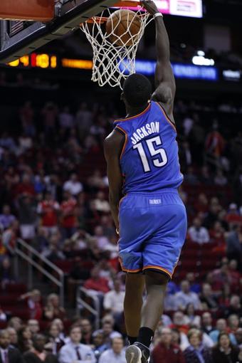 Jan 16, 2014; Houston, TX, USA; Oklahoma City Thunder point guard Reggie Jackson (15) dunks the ball during the fourth quarter against the Houston Rockets at Toyota Center. Mandatory Credit: Andrew Richardson-USA TODAY Sports