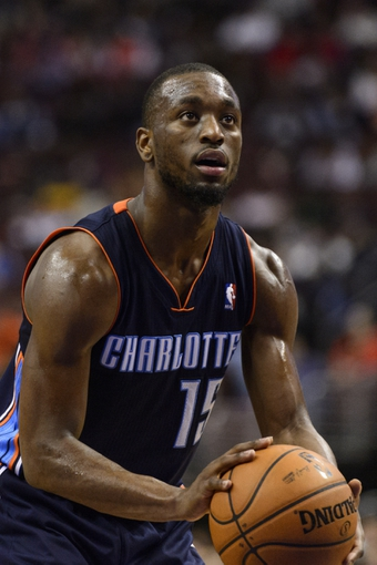 Jan 15, 2014; Philadelphia, PA, USA; Charlotte Bobcats guard Kemba Walker (15) shoots a foul shot during the third quarter against the Philadelphia 76ers at the Wells Fargo Center. The Sixers defeated the Bobcats 95-92. Mandatory Credit: Howard Smith-USA TODAY Sports