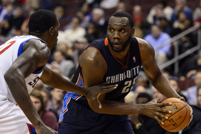 Jan 15, 2014; Philadelphia, PA, USA; Charlotte Bobcats center Al Jefferson (25) is defended by Philadelphia 76ers center Dewayne Dedmon (30) during the third quarter at the Wells Fargo Center. The Sixers defeated the Bobcats 95-92. Mandatory Credit: Howard Smith-USA TODAY Sports