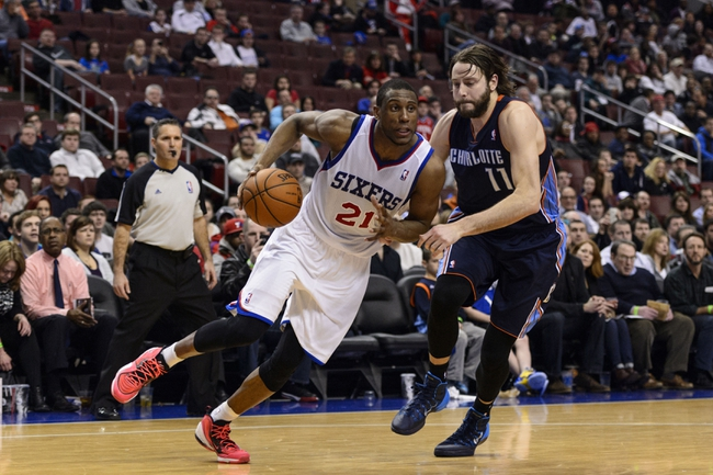 Jan 15, 2014; Philadelphia, PA, USA; Philadelphia 76ers forward Thaddeus Young (21) is defended by Charlotte Bobcats forward Josh McRoberts (11) during the fourth quarter at the Wells Fargo Center. The Sixers defeated the Bobcats 95-92. Mandatory Credit: Howard Smith-USA TODAY Sports