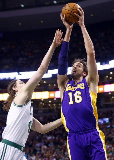 Jan 17, 2014; Boston, MA, USA; Los Angeles Lakers center Pau Gasol (16) works the ball against Boston Celtics center Kelly Olynyk (41) in the first quarter at TD Garden. Mandatory Credit: David Butler II-USA TODAY Sports