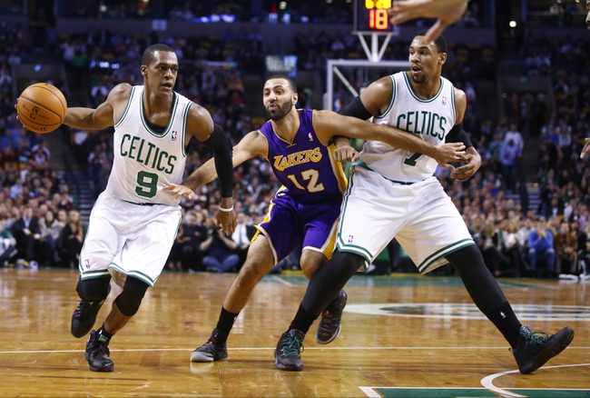 Jan 17, 2014; Boston, MA, USA; Boston Celtics point guard Rajon Rondo (9) drives the ball against Los Angeles Lakers point guard Kendall Marshall (12) in the first quarter at TD Garden. Mandatory Credit: David Butler II-USA TODAY Sports