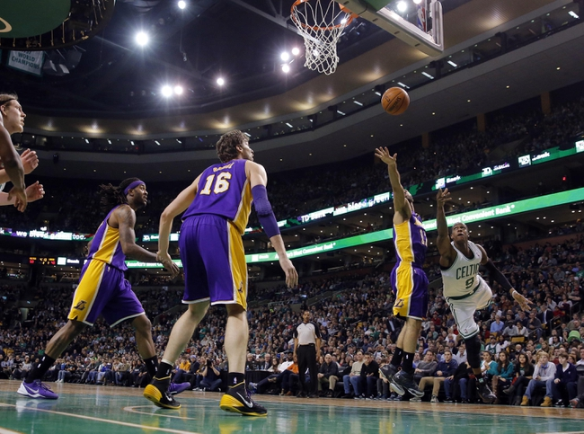 Jan 17, 2014; Boston, MA, USA; Boston Celtics point guard Rajon Rondo (9) shoots against Los Angeles Lakers point guard Kendall Marshall (12) in the first quarter at TD Garden. Mandatory Credit: David Butler II-USA TODAY Sports