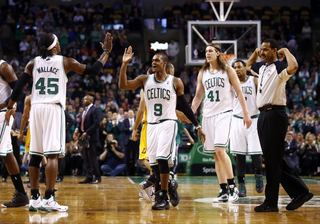 Jan 17, 2014; Boston, MA, USA; Boston Celtics point guard Rajon Rondo (9) on the court with his teammates as they take on the Los Angeles Lakers in the first quarter at TD Garden. Mandatory Credit: David Butler II-USA TODAY Sports