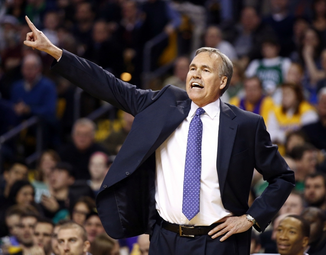 Jan 17, 2014; Boston, MA, USA; Los Angeles Lakers head coach Mike D'Antoni watches from the sideline as they take on the Boston Celtics in the second half at TD Garden. The Los Angeles Lakers defeated the Celtics 107-104. Mandatory Credit: David Butler II-USA TODAY Sports