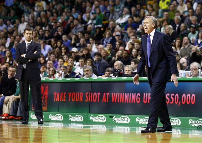 Jan 17, 2014; Boston, MA, USA; Los Angeles Lakers head coach Mike D'Antoni and Boston Celtics head coach Brad Stevens on the sideline in the second half at TD Garden. The Los Angeles Lakers defeated the Celtics 107-104. Mandatory Credit: David Butler II-USA TODAY Sports