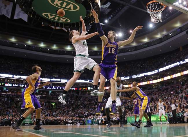 Jan 17, 2014; Boston, MA, USA; Los Angeles Lakers center Pau Gasol (16) defends against Boston Celtics center Kelly Olynyk (41) in the second half at TD Garden. The Los Angeles Lakers defeated the Celtics 107-104. Mandatory Credit: David Butler II-USA TODAY Sports