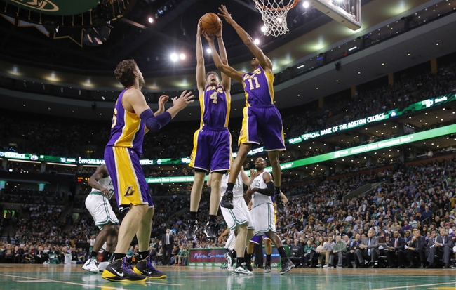 Jan 17, 2014; Boston, MA, USA; Los Angeles Lakers power forward Ryan Kelly (4) and shooting guard Wesley Johnson (11) grab the rebound against the Boston Celtics in the second half at TD Garden. The Los Angeles Lakers defeated the Celtics 107-104. Mandatory Credit: David Butler II-USA TODAY Sports