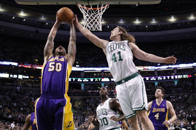 Jan 17, 2014; Boston, MA, USA; Los Angeles Lakers center Robert Sacre (50) grabs the rebound against Boston Celtics center Kelly Olynyk (41) in the second half at TD Garden. Lakers won107-104. Mandatory Credit: David Butler II-USA TODAY Sports