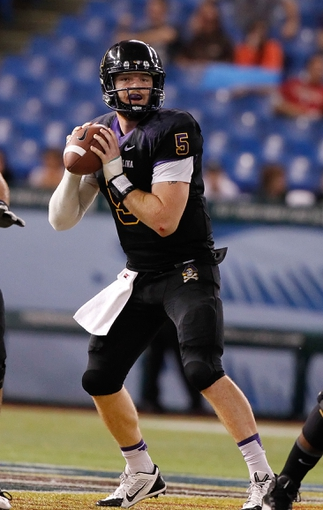 Dec 23, 2013; St. Petersburg, FL, USA; East Carolina Pirates quarterback Shane Carden (5) drops back against the Ohio Bobcats during the second half at the 2013 Beef O Bradys Bowl at Tropicana Field. East Carolina Pirates defeated the Ohio Bobcats 37-20. Mandatory Credit: Kim Klement-USA TODAY Sports