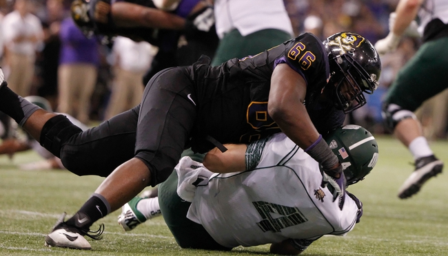 Dec 23, 2013; St. Petersburg, FL, USA; East Carolina Pirates defensive end Terrell Stanley (66) sacks Ohio Bobcats quarterback Tyler Tettleton (4) during the second half at the 2013 Beef O Bradys Bowl at Tropicana Field. East Carolina Pirates defeated the Ohio Bobcats 37-20. Mandatory Credit: Kim Klement-USA TODAY Sports