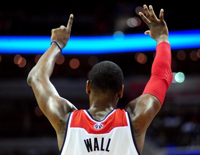 Jan 18, 2014; Washington, DC, USA; Washington Wizards guard John Wall (2) signals to teammates in the second quarter against the Detroit Pistons at Verizon Center. Mandatory Credit: Evan Habeeb-USA TODAY Sports