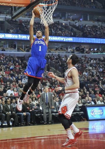 Jan 18, 2014; Chicago, IL, USA; Philadelphia 76ers point guard Michael Carter-Williams (1) goes up for shot as Chicago Bulls shooting guard Kirk Hinrich (12) looks on during the first quarter at the United Center. Mandatory Credit: David Banks-USA TODAY Sports