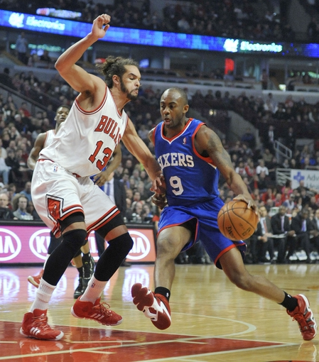 Jan 18, 2014; Chicago, IL, USA; Chicago Bulls center Joakim Noah (13) defends Philadelphia 76ers shooting guard James Anderson (9) during the first quarter at the United Center. Mandatory Credit: David Banks-USA TODAY Sports