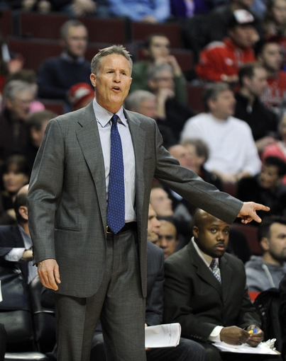 Jan 18, 2014; Chicago, IL, USA; Philadelphia 76ers head coach Brett Browncoaches against the Chicago Bulls during the first quarter at the United Center. Mandatory Credit: David Banks-USA TODAY Sports