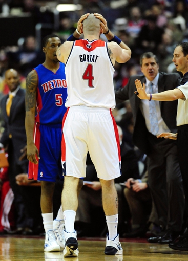 Jan 18, 2014; Washington, DC, USA; Washington Wizards center Marcin Gortat (4) reacts after a foul call in the game against the Detroit Pistons at Verizon Center. Mandatory Credit: Evan Habeeb-USA TODAY Sports