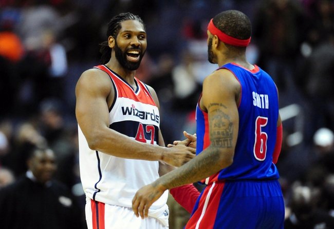Jan 18, 2014; Washington, DC, USA; Detroit Pistons forward Josh Smith (6) is congratulated by Washington Wizards forward Nene (42) after the Pistons beat the Wizards 104-98 at Verizon Center. Mandatory Credit: Evan Habeeb-USA TODAY Sports