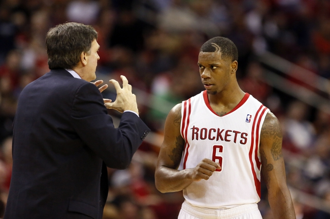 Jan 18, 2014; Houston, TX, USA; Houston Rockets head coach Kevin McHale talks to forward Terrence Jones (6) during the second half against the Milwaukee Bucks at Toyota Center. The Rockets won 114-104. Mandatory Credit: Soobum Im-USA TODAY Sports