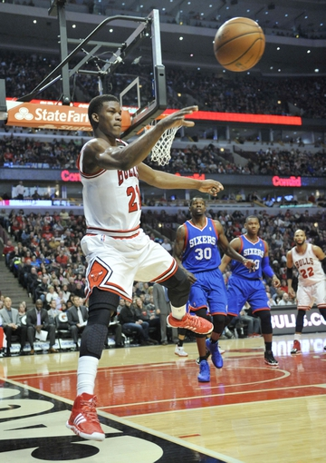 Jan 18, 2014; Chicago, IL, USA; Chicago Bulls shooting guard Jimmy Butler (21) saves the ball from going out of bounds against the Philadelphia 76ers  during the second half at the United Center. The Chicago Bulls defeated the Philadelphia 76ers 103-78. Mandatory Credit: David Banks-USA TODAY Sports