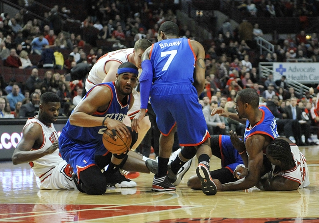 Jan 18, 2014; Chicago, IL, USA; Philadelphia 76ers power forward Brandon Davies (20) comes up with a loose ball against the Chicago Bulls during the second half at the United Center. The Chicago Bulls defeated the Philadelphia 76ers 103-78. Mandatory Credit: David Banks-USA TODAY Sports