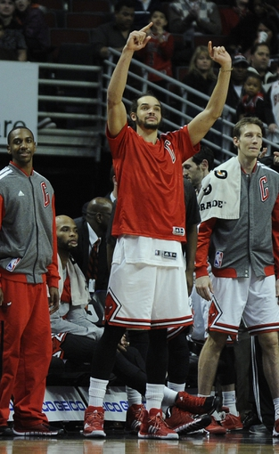 Jan 18, 2014; Chicago, IL, USA;  Chicago Bulls center Joakim Noah (center) reacts as time runs out during the second half at the United Center. The Chicago Bulls defeated the Philadelphia 76ers 103-78. Mandatory Credit: David Banks-USA TODAY Sports