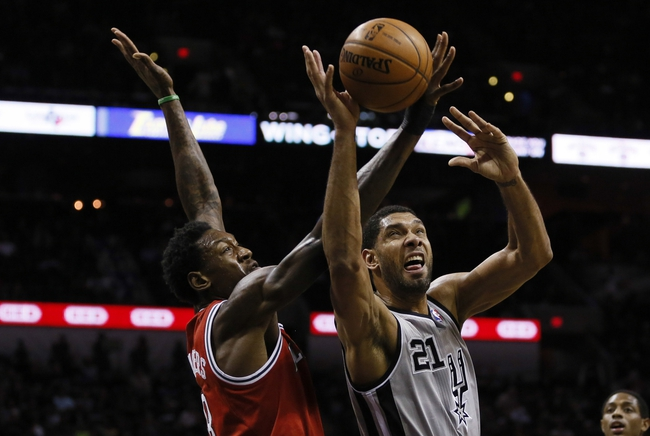 Jan 19, 2014; San Antonio, TX, USA; San Antonio Spurs forward Tim Duncan (21) drives to the basket as Milwaukee Bucks center Larry Sanders (left) defends during the first half at AT&T Center. Mandatory Credit: Soobum Im-USA TODAY Sports