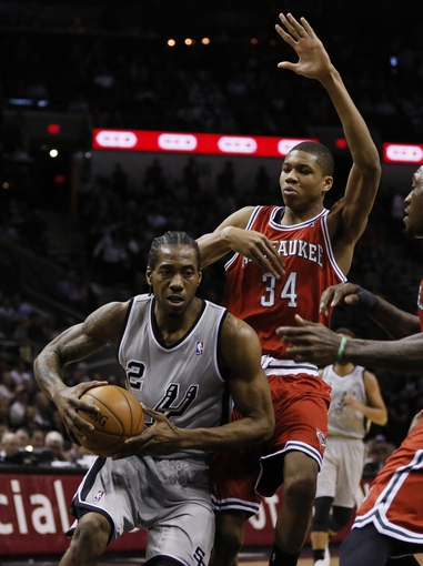 Jan 19, 2014; San Antonio, TX, USA; San Antonio Spurs forward Kawhi Leonard (2) drives to the basket as Milwaukee Bucks guard Giannis Antetokounmpo (34) and guard Nate Wolters (6) defend during the first half at AT&T Center. Mandatory Credit: Soobum Im-USA TODAY Sports