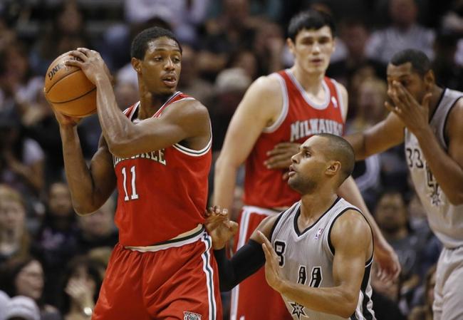 Jan 19, 2014; San Antonio, TX, USA; Milwaukee Bucks guard Brandon Knight (11) is defended by San Antonio Spurs guard Patrick Mills (8) during the first half at AT&T Center. Mandatory Credit: Soobum Im-USA TODAY Sports