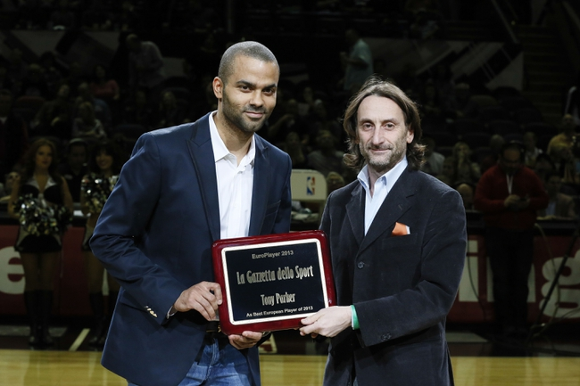 Jan 19, 2014; San Antonio, TX, USA; San Antonio Spurs guard Tony Parker (left) is named the 2013 European Player of the year and is awarded by Massimo Lopes Pegna (right) before the game against the Milwaukee Bucks at AT&T Center. Mandatory Credit: Soobum Im-USA TODAY Sports