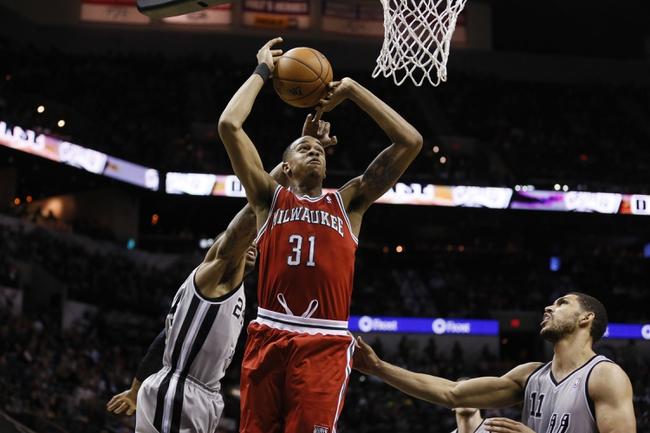 Jan 19, 2014; San Antonio, TX, USA; Milwaukee Bucks center John Henson (31) has his shot blocked by San Antonio Spurs forward Malcolm Thomas (behind) during the second half at AT&T Center. The Spurs won 110-82. Mandatory Credit: Soobum Im-USA TODAY Sports