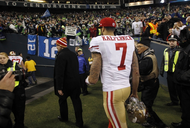 Jan 19, 2014; Seattle, WA, USA; San Francisco 49ers quarterback Colin Kaepernick (7) leaves the field after the 2013 NFC Championship football game against the Seattle Seahawks at CenturyLink Field. Mandatory Credit: Joe Nicholson-USA TODAY Sports
