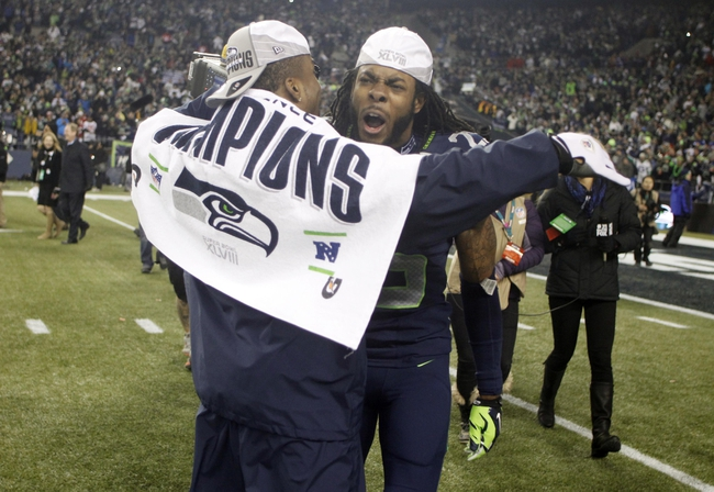 Jan 19, 2014; Seattle, WA, USA; Seattle Seahawks cornerback Richard Sherman (right) celebrates with teammates after the 2013 NFC Championship football game against the San Francisco 49ers at CenturyLink Field. Mandatory Credit: Joe Nicholson-USA TODAY Sports
