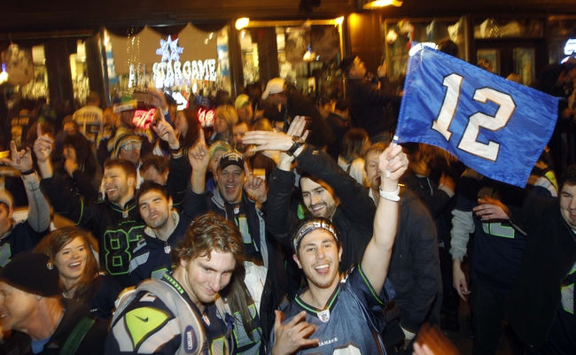 Jan 19, 2014; Seattle, WA, USA; Seattle Seahawks fans celebrate in the streets after the 2013 NFC Championship football game against the San Francisco 49ers at CenturyLink Field. Mandatory Credit: Joe Nicholson-USA TODAY Sports