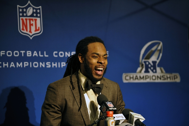 Jan 19, 2014; Seattle, WA, USA; Seattle Seahawks cornerback Richard Sherman (25) addresses the media after the 2013 NFC Championship football game against the San Francisco 49ers at CenturyLink Field. Mandatory Credit: Steven Bisig-USA TODAY Sports