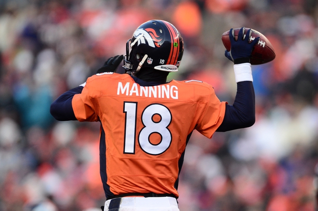 Dec 8, 2013; Denver, CO, USA; Denver Broncos quarterback Peyton Manning (18) prepares to pass in the second quarter against the Tennessee Titans at Sports Authority Field at Mile High. Mandatory Credit: Ron Chenoy-USA TODAY Sports