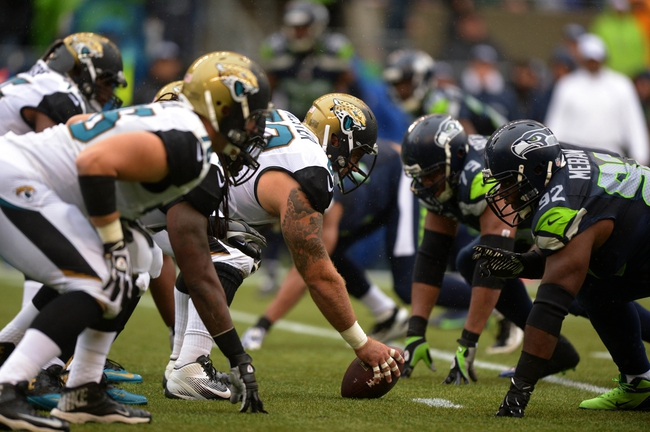 Sep 22, 2013; Seattle, WA, USA; General view of the line of scrimmage as Jacksonville Jaguars center Brad Meester (63) snaps the ball against the Seattle Seahawks CenturyLink Field. The Seahawks defeated the Jaguars 45-17. Mandatory Credit: Kirby Lee-USA TODAY Sports