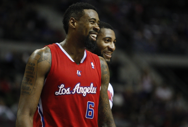 Jan 20, 2014; Auburn Hills, MI, USA; Los Angeles Clippers center DeAndre Jordan (6) and Detroit Pistons center Andre Drummond (0) share a laugh during the fourth quarter at The Palace of Auburn Hills. Clippers beat the Pistons 112-103. Mandatory Credit: Raj Mehta-USA TODAY Sports
