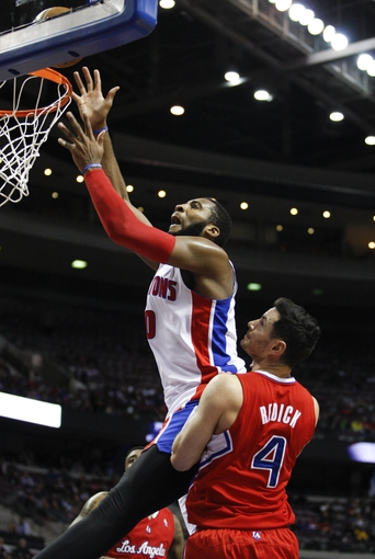 Jan 20, 2014; Auburn Hills, MI, USA; Detroit Pistons center Andre Drummond (0) takes a shot as he is defended by Los Angeles Clippers shooting guard J.J. Redick (4) during the fourth quarter at The Palace of Auburn Hills. Clippers beat the Pistons 112-103. Mandatory Credit: Raj Mehta-USA TODAY Sports