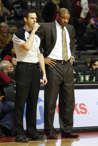 Jan 20, 2014; Auburn Hills, MI, USA; Los Angeles Clippers head coach Doc Rivers stands next to a ref during the fourth quarter against the Detroit Pistons at The Palace of Auburn Hills. Clippers beat the Pistons 112-103. Mandatory Credit: Raj Mehta-USA TODAY Sports
