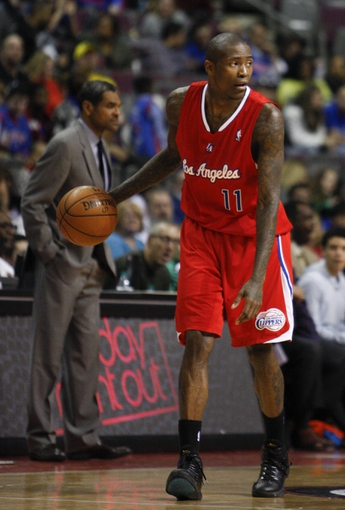 Jan 20, 2014; Auburn Hills, MI, USA; Los Angeles Clippers shooting guard Jamal Crawford (11) dribbles the ball during the fourth quarter against the Detroit Pistons at The Palace of Auburn Hills. Clippers beat the Pistons 112-103. Mandatory Credit: Raj Mehta-USA TODAY Sports