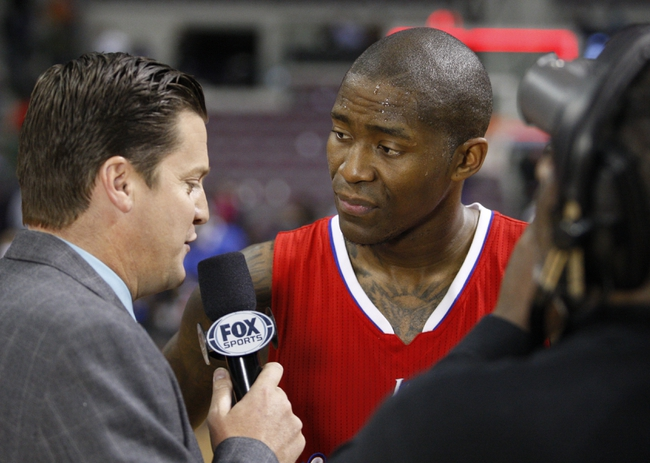 Jan 20, 2014; Auburn Hills, MI, USA; Los Angeles Clippers shooting guard Jamal Crawford (11) does a post game interview after the game against the Detroit Pistons at The Palace of Auburn Hills. Clippers beat the Pistons 112-103. Mandatory Credit: Raj Mehta-USA TODAY Sports