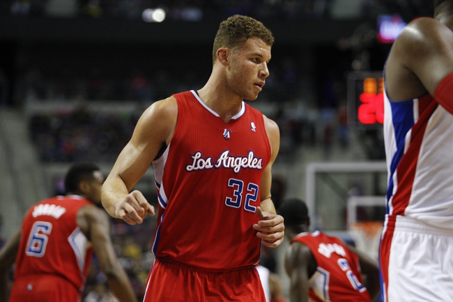 Jan 20, 2014; Auburn Hills, MI, USA; Los Angeles Clippers power forward Blake Griffin (32) gets ready for a play during the third quarter against the Detroit Pistons at The Palace of Auburn Hills. Clippers beat the Pistons 112-103. Mandatory Credit: Raj Mehta-USA TODAY Sports