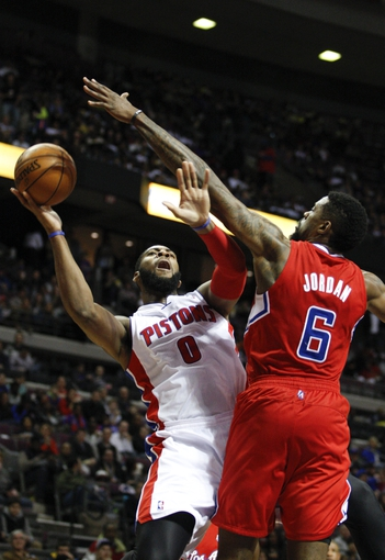Jan 20, 2014; Auburn Hills, MI, USA; Detroit Pistons center Andre Drummond (0) attempts a shot over Los Angeles Clippers center DeAndre Jordan (6) during the third quarter at The Palace of Auburn Hills. Clippers beat the Pistons 112-103. Mandatory Credit: Raj Mehta-USA TODAY Sports